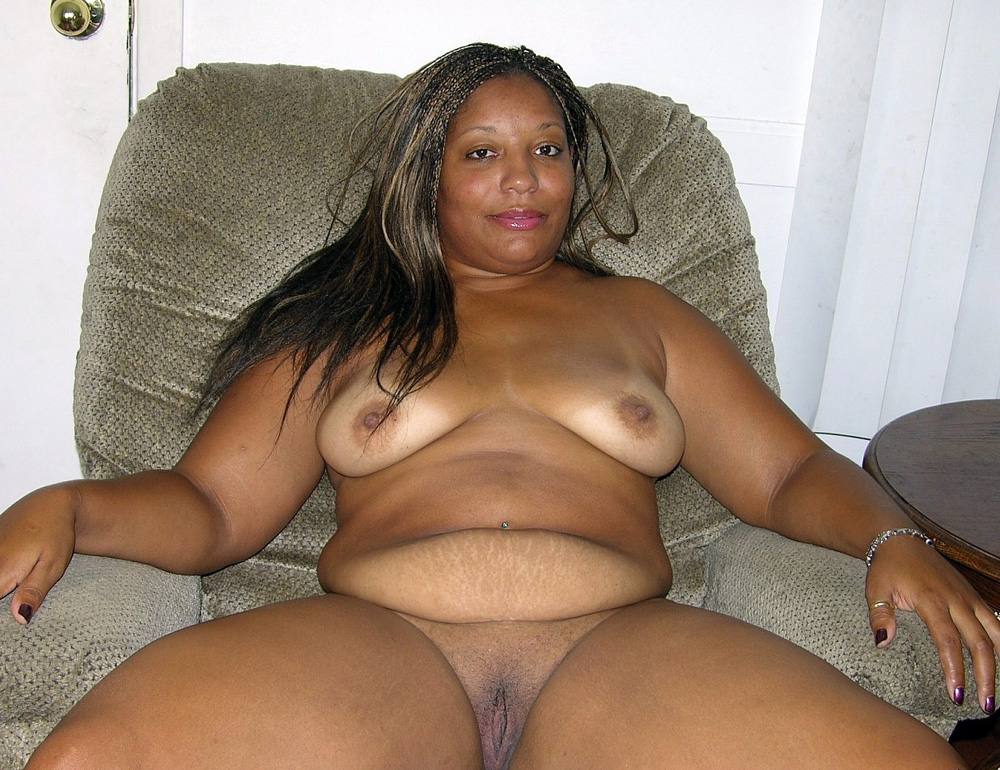Very fat black mature woman sitting naked