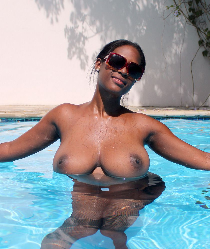 Sexy black chick exposing her buoyant boobs